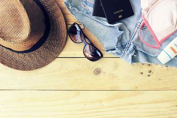 travel concept. set of women's accessories seen from above with free text space. summer holiday. over light and retro tone