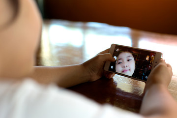Cute girl making a funny selfie.
