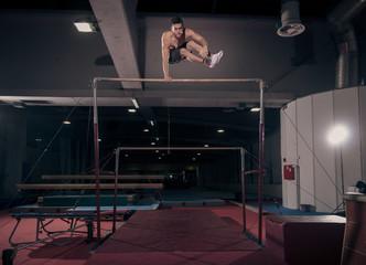 man gymnast, gymnastic horizontal bar, in air