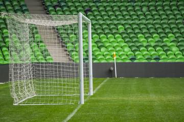 Football, soccer field. Soccer goal. Background of soccer football goal in stadium on match day