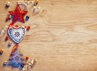Christmas toys on wooden board. Top view. Merry Christmas and Happy New Year!