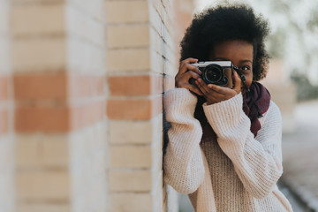 Woman shooting at her camera