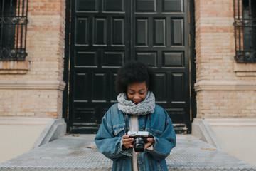 Woman browsing photos in camera