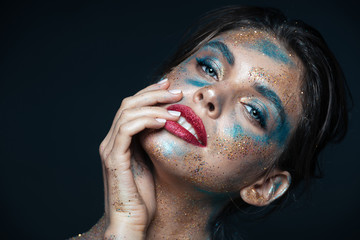 Beauty portrait of gorgeous young woman with blue shining makeup