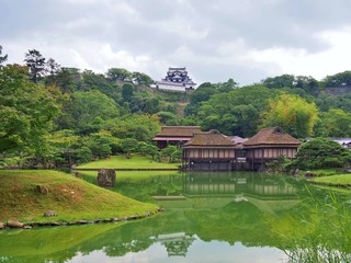 Genkyuen Garden in Hikone, Shiga Prefecture, Japan. Genkyuen Garden is a Japanese garden with a central pond and a circular walking trail. It was built on the grounds of Hikone Castle in 1677.