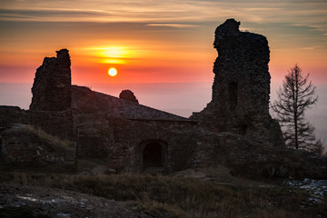 The Ruins of Lichnice Castle in Czech Republic with sunset in background.