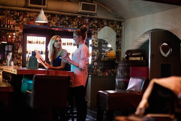 Waitress discussing the menu with the customer