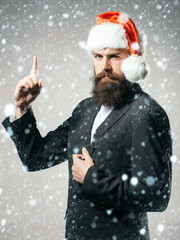 Bearded man in santa claus hat