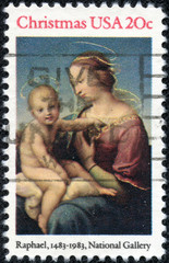stamp printed in USA shows painting by artist Raphael, Madonna and Child