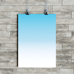 Paper blank poster template hanging over wall. 3D illustration