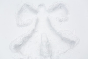 angel silhouette or print on snow surface
