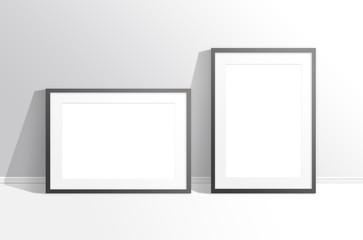 Two blank frames against the wall, mock up. Interior decor