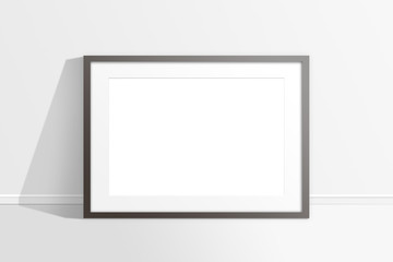 Blank photo frame against the wall, mock up.