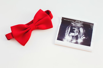 Ultrasound and red tie