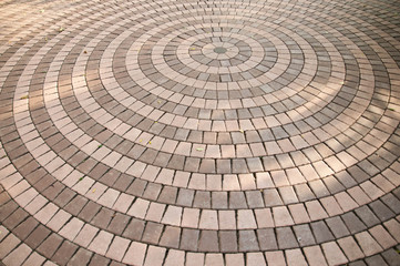 Concrete paving blocks, sorted into circle.
