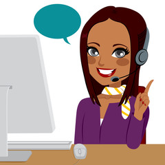 Beautiful young brunette Indian woman working on call center helping customer
