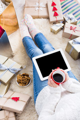 Woman shopping online with a credit card, top view