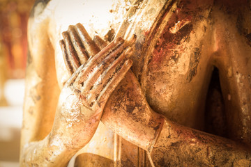Close up hand of statue Buddha.buddhism concept