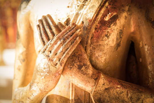 Close up hand of statue Buddha.buddhism concept