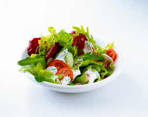 Salad with tomato, radishes, and dressing