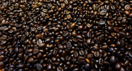 Roasted coffee beans with blurred focus for background