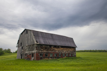old barn in a large field