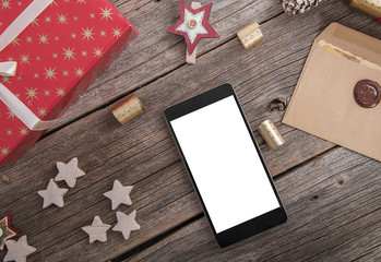 Smartphone on a wooden Christmas table.