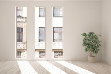 White room with flower and urban landscape in window. Scandinavian interior design