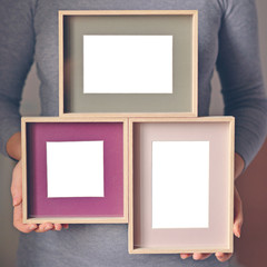 Woman holding blank wooden frames