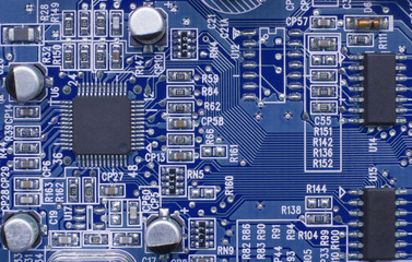 Printed circuit board with electronic components. Computer and technology concept. Toned image.
