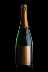 Champagne bottle with gold label on black background