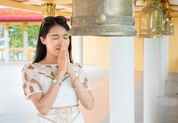 Buddhist girl praying inside the temple