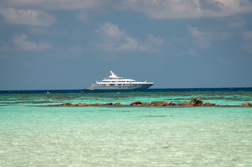 Luxury private motor yacht near the coral reef