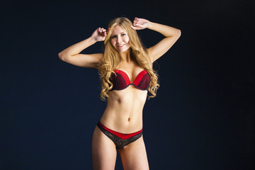 young blonde woman posing in red underwear