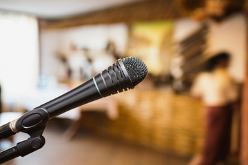 A microphone on a dark background. Evening in the restaurant. Conduct performance