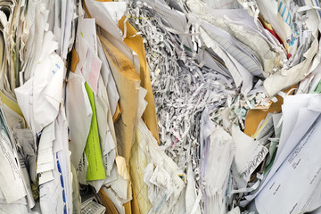 paper piled and getting ready to recycle