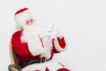 Santa Claus Reading Letter isolated over white baclground