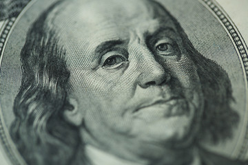Benjamin Franklin's portrait on one hundred dollar bill
