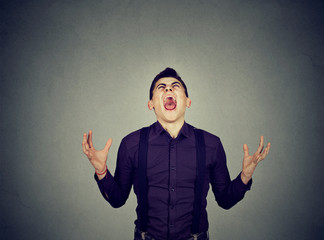 Frustrated desperate young man screaming