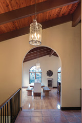 Arched entry leading to kitchen