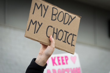 Pro-choice Planned Parenthood demonstration holding a sign