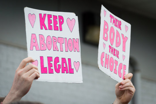 Pro-choice Planned Parenthood demonstration holding two signs