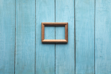 wooden photo frame on wooden wall