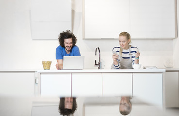 Lovely couple in their kitchen
