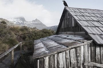 Boat shed in Dove Lake, Tasmania on a snowy and overcast day.