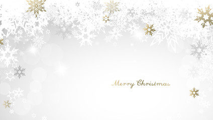Christmas light background with golden and white snowflakes and