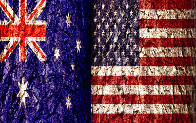 Australia Flag and United States Flag over crack and grunge wall texture background. Forex AUDUSD concept.