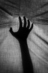 The concept of the shadow of hand behind cloth