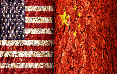 United States Flag and China Flag over crack and grunge wall texture background. Forex USDCNH concept.