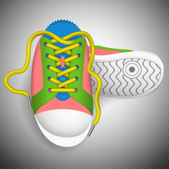 Colorful sneakers on a grey background.